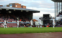 """Sunday 07 December 2014<br /> Pictured L-R: Swansea players Ashley Williams, Wayne Routledge, Ashley """"Jazz"""" Richards, Wilfried Bony and Gylfi Sigurdsson walk off the pitch disappointed after the end of the game <br /> Re: Premier League West Ham United v Swansea City FC at Boleyn Ground, London, UK."""