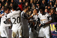 Saturday, 08 February 2014<br /> Pictured: Wayne Routledge of Swansea (2nd R) celebrating his opening goal with Chico Flores (3rd L) and other players<br /> Re: Barclay's Premier League, Swansea City FC v Cardiff City at the Liberty Stadium, south Wales, UK.