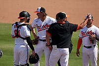 Baltimore Orioles pitcher Hunter Harvey (56) gets looked at by a member of the training staff after being injured on a pitch during a Major League Spring Training game against the Philadelphia Phillies on March 12, 2021 at the Ed Smith Stadium in Sarasota, Florida.  (Mike Janes/Four Seam Images)