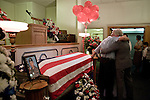 August 25, 2007. Kinston, NC.. A viewing of the coffin of Spc. Steven R. Jewell was held at Howard and Carter Funeral Home i Kinston, NC. Spc. Steven R. Jewell was killed in a helicopter crash  near the Iraqi city of Fallujah on August 14, 2007.. Jack Wisener, Spc. Jewell's stepfather, lays a hand on the coffin of his stepson and hugs a friend.. .. .