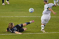 SAN JOSE, CA - SEPTEMBER 19: Florian Jungwirth #23 of the San Jose Earthquakes tackles Cristhian Paredes during a game between Portland Timbers and San Jose Earthquakes at Earthquakes Stadium on September 19, 2020 in San Jose, California.