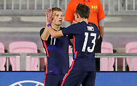 FORT LAUDERDALE, FL - DECEMBER 09: Chris Mueller #11 of the United States heads home a scoring goal and celebrates with team mate Sam Vines #13 during a game between El Salvador and USMNT at Inter Miami CF Stadium on December 09, 2020 in Fort Lauderdale, Florida.