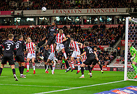 1st October 2021;  Bet365 Stadium, Stoke, Staffordshire, England; EFL Championship football, Stoke City versus West Bromwich Albion; Semi Ajayi of West Bromwich Albion heads the ball clear of his box
