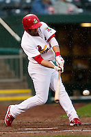 Alex Castellanos (18) of the Springfield Cardinals makes contact on a pitch during a game against the Northwest Arkansas Naturals on May 13, 2011 at Hammons Field in Springfield, Missouri.  Photo By David Welker/Four Seam Images.