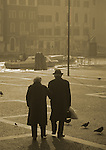 Elderly couple at daybreak in Venice, Italy