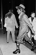 Manhattan, New York City, NY - January 28, 1974<br /> Muhammad Ali and Joe Frazier at Madison Square Garden  - Billed as the 'Fight of the Century' African-American boxing fans and dandies attended wearing the most glam-fashions of the day. Furs, minis and thigh-high platform boots were all the rage.