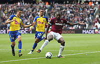 West Ham United's Michail Antonio holds off Southampton's Yan Valery and Mohamed Elyounoussi<br /> <br /> Photographer Rob Newell/CameraSport<br /> <br /> The Premier League - West Ham United v Southampton - Saturday 4th May 2019 - London Stadium - London<br /> <br /> World Copyright © 2019 CameraSport. All rights reserved. 43 Linden Ave. Countesthorpe. Leicester. England. LE8 5PG - Tel: +44 (0) 116 277 4147 - admin@camerasport.com - www.camerasport.com
