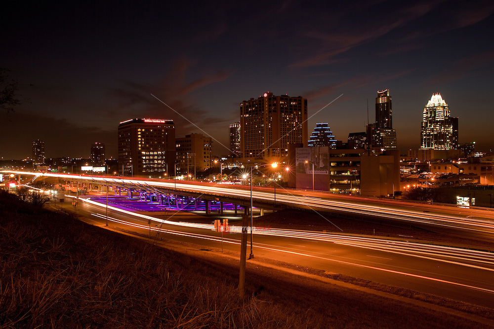 USA, Texas, Austin, city skyline, elevated view from IH-35 at night.