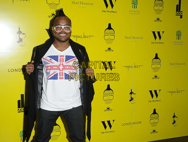 Apl.de.ap (Allan Pineda Lindo, Jr.) of The Black Eyed Peas.The Apl.de.Ap Foundation charity dinner to raise funds for the 'We Can Be Anything' campaign, The Westbury Hotel, London, England..May 19th, 2012.half 3/4 length black jacket grey gray trousers beard facial hair black glasses white top union jack mohawk flag  .CAP/CAN.©Can Nguyen/Capital Pictures.