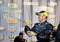 Feb 22, 2009; Fontana, CA, USA; NASCAR Sprint Cup Series driver Matt Kenseth celebrates with champagne after winning the Auto Club 500 at Auto Club Speedway. Mandatory Credit: Mark J. Rebilas-