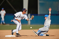 Jake Jefferies #4 of the Cal State Fullerton Titans can't hold onto a throw as Eric Filia #4 of the UCLA Bruins slides into second base during the NCAA Super Regional at Goodwin Field on June 7, 2013 in Fullerton, California. UCLA defeated Cal State Fullerton, 5-3. (Larry Goren/Four Seam Images)