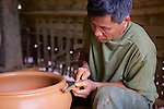 Man Making Pottery