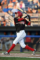 Batavia Muckdogs third baseman Hiram Martinez (15) at bat during a game against the Auburn Doubledays on August 27, 2014 at Dwyer Stadium in Batavia, New York.  Auburn defeated Batavia 6-4.  (Mike Janes/Four Seam Images)