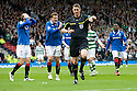 :: RANGERS' SASA PAPAC AND NIKICA JELAVIC CLAIM A PENALTY AFTER THE BALL SEEMED TO STRIKE THE ARM OF CELTIC'S MARK WILSON BUT REF CRAIG THOMSON WAVES PLAY ON ::