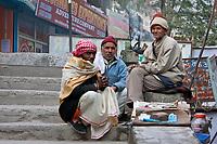 India, Rishikesh.  Three Men Talking.