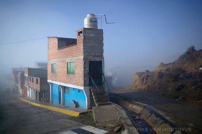 A house which stands near contaminated mine tailings is seen in the Paragsha neighborhood of Cerro de Pasco on June 10, 2013.