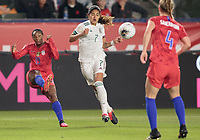 CARSON, CA - FEBRUARY 7: Crystal Dunn #19 of the United States clears a ball past Daniela Espinosa #7 of Mexico during a game between Mexico and USWNT at Dignity Health Sports Park on February 7, 2020 in Carson, California.