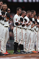 SAN FRANCISCO, CA - APRIL 5:  Joe Panik #12 of the San Francisco Giants participates in pregame ceremonies on the field before the game against the Tampa Bay Rays at Oracle Park on Friday, April 5, 2019 in San Francisco, California. (Photo by Brad Mangin)