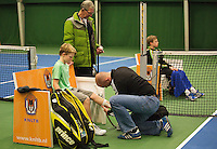 01-12-13,Netherlands, Almere,  National Tennis Center, Tennis, Winter Youth Circuit, Treatment by fysio  <br /> Photo: Henk Koster