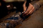 NAJAF, IRAQ: A metalsmith works on a design in the Najaf market...Daily life continues in relative peace in the Iraqi city of Najaf...Photo by Ali Arkady/Metrography