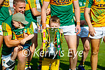 Paul Geaney's son Páidí lifts the cup after the Munster GAA Football Senior Championship Final match between Kerry and Cork at Fitzgerald Stadium in Killarney on Sunday.