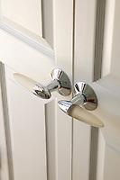 Modern white glass and chrome door handles