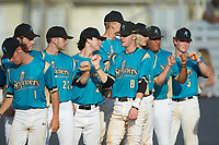 Kye Andress (6) (Catawba Valley CC) of the Mooresville Spinners bumps fists with teammates during player introductions prior to the game against the Lake Norman Copperheads at Moor Park on July 6, 2020 in Mooresville, NC.  The Spinners defeated the Copperheads 3-2. (Brian Westerholt/Four Seam Images)