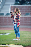 A young singer performs the National Anthem before a Pioneer League game between the Idaho Falls Chukars and the Billings Mustangs at Melaleuca Field on August 22, 2018 in Idaho Falls, Idaho. The Idaho Falls Chukars defeated the Billings Mustangs by a score of 5-3. (Zachary Lucy/Four Seam Images)