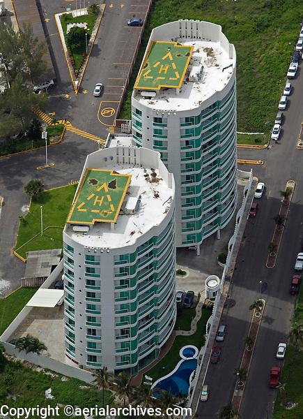 aerial photograph of helipads on the rooftops of residential towers, Veracruz, Mexico | fotografía aérea de helipuertos en los tejados de torres residenciales, Veracruz, México