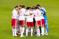 New York Red Bulls players huddle prior to the start of the match. D. C. United defeated the New York Red Bulls 1-0 (2-1 in aggregate) during the second leg of the MLS Eastern Conference Semifinals at Red Bull Arena in Harrison, NJ, on November 8, 2012.