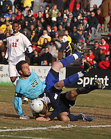 Chris Blais #23 of the University Michigan crashes into Brian Klemczak #15 during an NCAA quarter-final match against the University of Maryland at Ludwig Field, University of Maryland, College Park, Maryland on December 4 2010.Michigan won 3-2 AET.