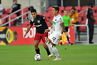 WASHINGTON, DC - JULY 7: Barlon Sequeira #22 of Liga Deportiva Alajuense battles for the ball with Yamil Asad #11 of D.C. United during a game between Liga Deportiva Alajuense  and D.C. United at Audi Field on July 7, 2021 in Washington, DC.