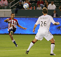 CD Chivas USA defender Jonathan Bornstein (13) passes a ball down field as DC United defender Bryan Namoff (26) looks on. CD Chivas USA tied D. C. United 2-2 during an MLS regular season match at the Home Depot Center, Carson, CA, on September 6, 2007.
