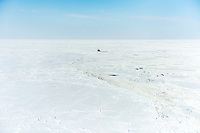 An ice-breaking vessel navigating through an ice field on the Northern Sea Route.