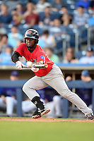 Frisco Rough Riders Odubel Herrera (16) attempts to lay down a bunt during the second game of a doubleheader against the Tulsa Drillers on May 29, 2014 at ONEOK Field in Tulsa, Oklahoma.  Frisco defeated Tulsa 3-2.  (Mike Janes/Four Seam Images)