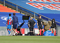 12th September 2020; Selhurst Park, London, England; English Premier League Football, Crystal Palace versus Southampton; Referee John Moss checks the VAR before retracting his decision to give a straight red card to Kyle Walker-Peters of Southampton for a tackle on Tyrick Mitchell of Crystal Palace after VAR ruled no red card but instead gives Kyle Walker-Peters of Southampton a yellow card