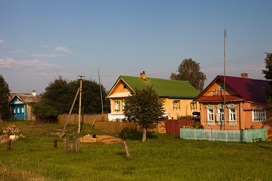 Korovikha, Ivanova Region, Russia, 05/08/2012..Traditional brightly painted Russian wooden homes in Korovikha, some 200 miles east of Moscow.