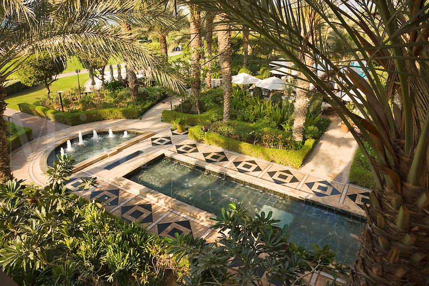 Dubai.  Moroccan style water garden at the Ritz Carlton Hotel at Jumeirah Beach..