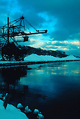 The coal unloader awaits a ship in Marquette Michigan's lower harbor, on Lake Superior. Circa 1960's.