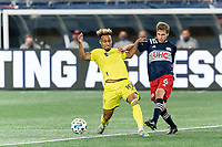 FOXBOROUGH, MA - OCTOBER 3: Hany Mukhtar #10 of Nashville SC andScott Caldwell #6 of New England Revolution battle for the ball during a game between Nashville SC and New England Revolution at Gillette Stadium on October 3, 2020 in Foxborough, Massachusetts.