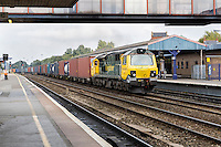 UK, England, Oxford.  Freight Train Passing through Oxford Station.