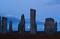 Autumn full moon rises behind Callanish standing stone, Isle of Lewis, Outer Hebrides, Scotland