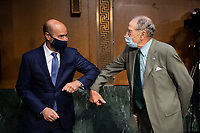 """United States Secretary of Labor Eugene Scalia, left, elbow bumps United States Senator Chuck Grassley (Republican of Iowa), Chairman, US Senate Committee on Finance, before the start of a hearing on """"COVID-19/Unemployment Insurance"""" on Capitol Hill in Washington on Tuesday, June 9, 2020. <br /> Credit: Caroline Brehman / Pool via CNP/AdMedia"""