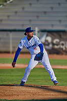 Ogden Raptors starting pitcher Juan Morillo (11) delivers a pitch to the plate against the Grand Junction Rockies at Lindquist Field on August 28, 2019 in Ogden, Utah. The Rockies defeated the Raptors 8-5. (Stephen Smith/Four Seam Images)
