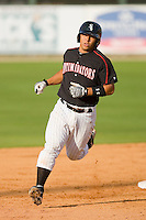 Miguel Gonzalez #12 of the Kannapolis Intimidators rounds the bases after hitting the first of two home runs on the day against the West Virginia Power at Fieldcrest Cannon Stadium April 25, 2010, in Kannapolis, North Carolina.  Photo by Brian Westerholt / Four Seam Images
