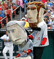 Washington Nationals mascots Abe Lincoln and George Washington participate in a dance contest during a Buffalo Bisons game against the Syracuse Chiefs at Coca-Cola Field on September 1, 2011 in Buffalo, New York.  Syracuse defeated Buffalo 6-2.  (Mike Janes/Four Seam Images)