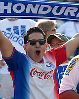 An Olimpia fan with a Honduras banner.  AC Milan defeated Olimpia 3-1 at Gillette Stadium on August 4, 2012