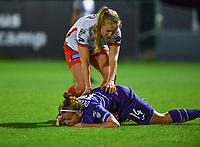 Laura Deloose (14) of Anderlecht pictured laying down with Corina Luijks (14) of Zulte-Waregem helping during a female soccer game between RSC Anderlecht Dames and SV Zulte Waregem on the 10 th matchday of the 2020 - 2021 season of Belgian Womens Super League , friday 18 th of December 2020  in Tubize , Belgium . PHOTO SPORTPIX.BE | SPP | DAVID CATRY