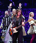 The Go-Go's: Kathy Valentine performs with the cast during a special curtain call at Broadway's 'Head Over Heels' on July 12, 2018 at the Hudson Theatre in New York City.