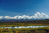 People photographing Mount McKinley from pond near the Wonder Lake campground.  Denali National Park, Alaska.  Sept.